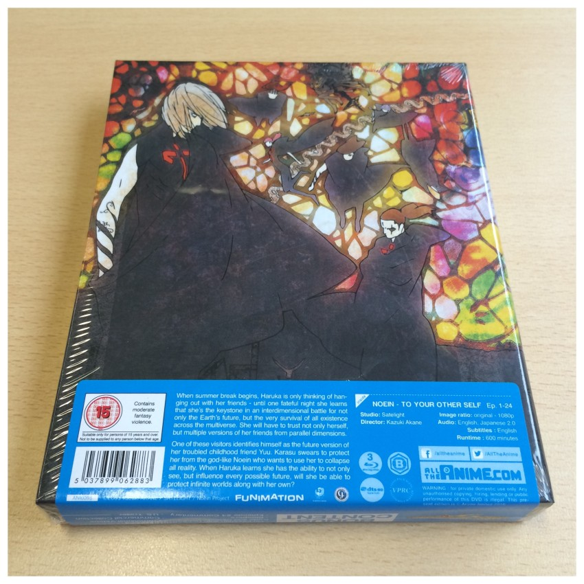 The back of the rigid case with the cellophane around it. Again, there is a sticker around on the cellophane not on the box itself.