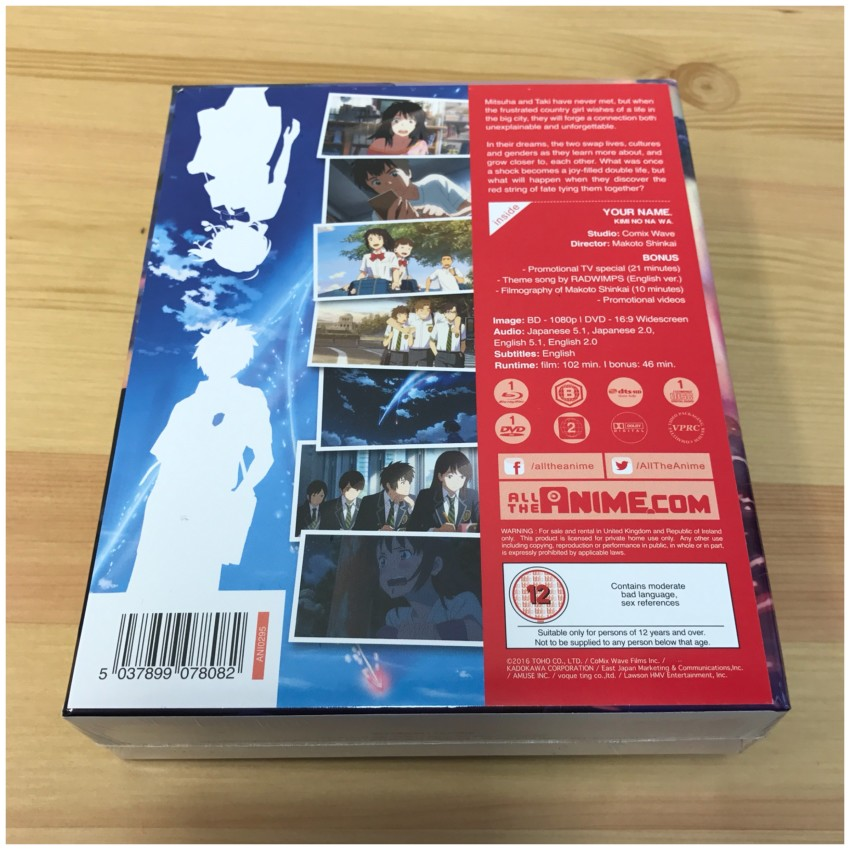 The reverse side of the box with the cellophane around it. The info sheet you see it attached to the box by a couple of glue dots. Peel away gently to remove.