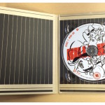 The inside of the digipack where the disc is held.