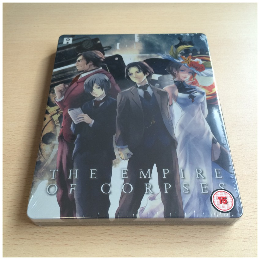 The front of the box, cellophane around it. NOTE: The BBFC logo is a sticker on the cellophane, not on the box itself.