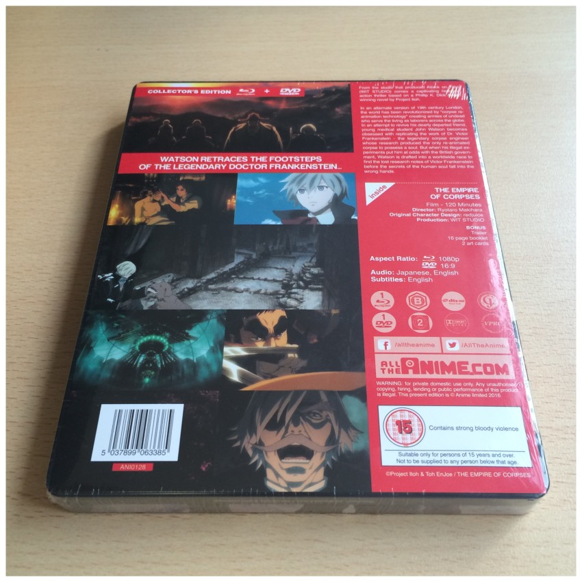 The back of the box, cellophane around it. What you see there is an info sheet attached to the back of the box by a couple of glue dots.