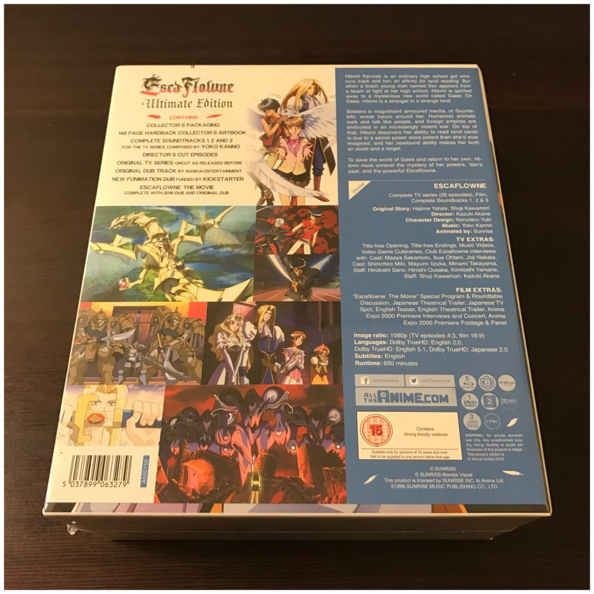 The back of the box, cellophane still around it. NOTE: The info sheet you see it attached to the box by glue dots, approximately 5 of them. This can be removed by gently peeling it away from the box.