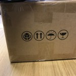 Instructions on both sides for postmen / couriers on which way up the package is meant to go and that it's fragile etc.