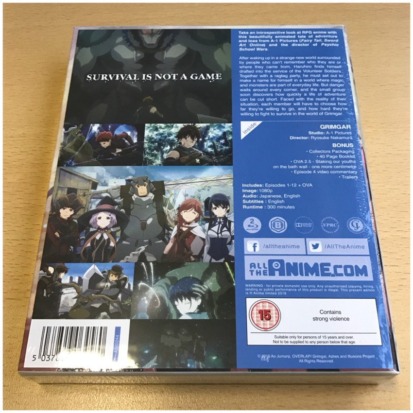 The reverse side of the rigid case, cellophane around the box. NOTE: The info sheet it attached to the box under the cellophane and can be removed. Just gently peel it away; it's attached via some glue dots