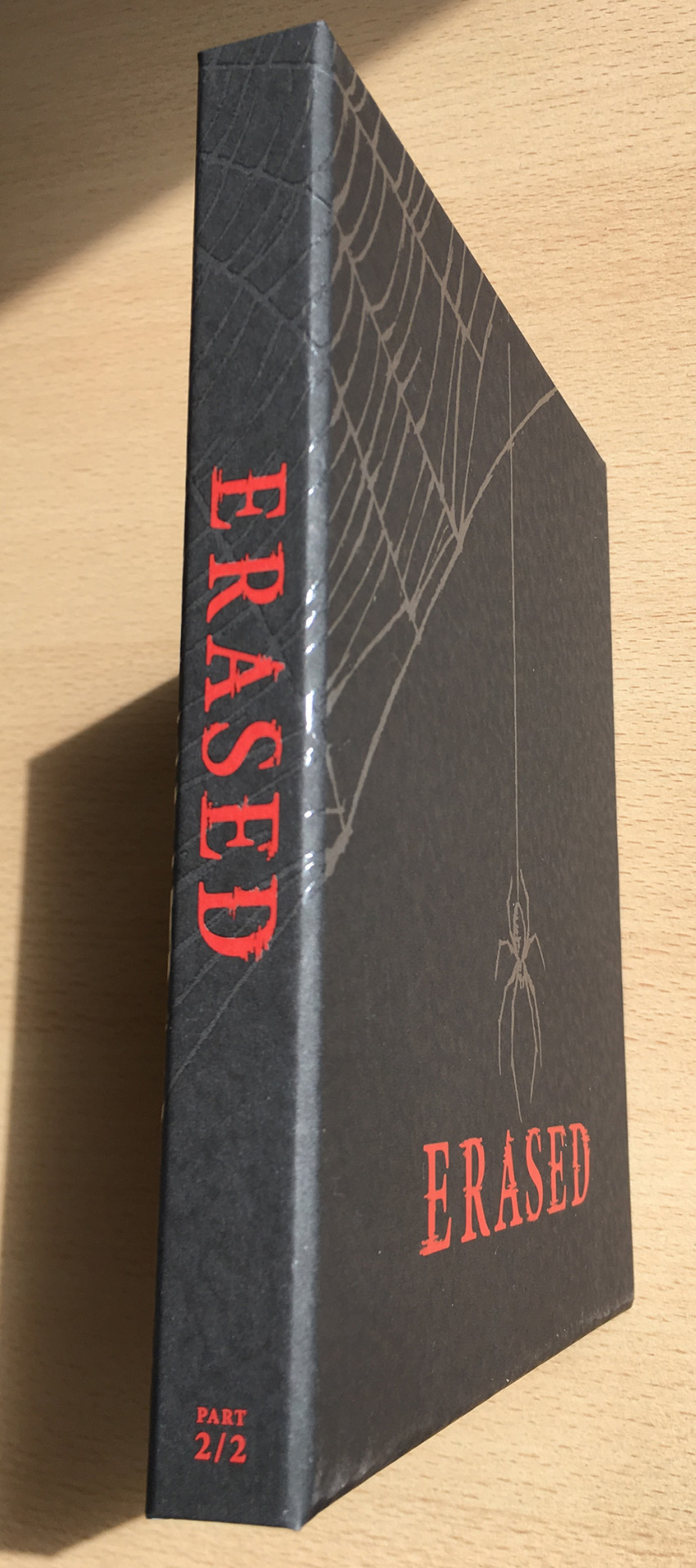 The spine of the rigid case boasts the series title