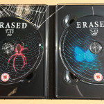 More spider webs within the digipak, but more importantly: the Blu-ray and DVD