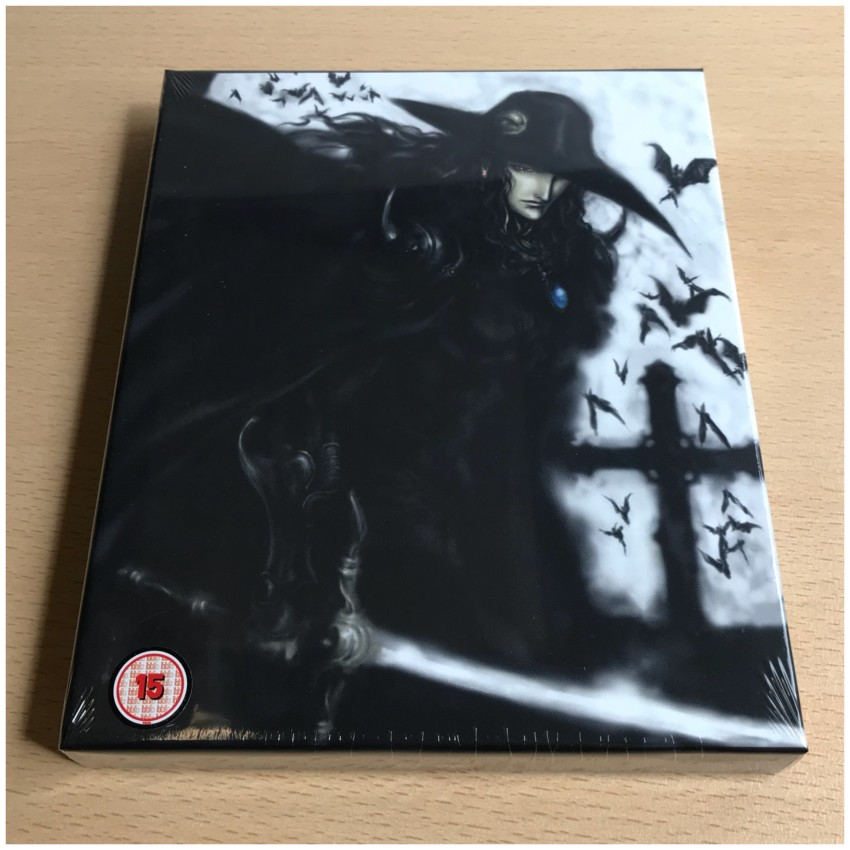 The front of the rigid case, cellophane around the box. (NOTE: The BBFC logo is a sticker on the the cellophane, not on the box itself.)