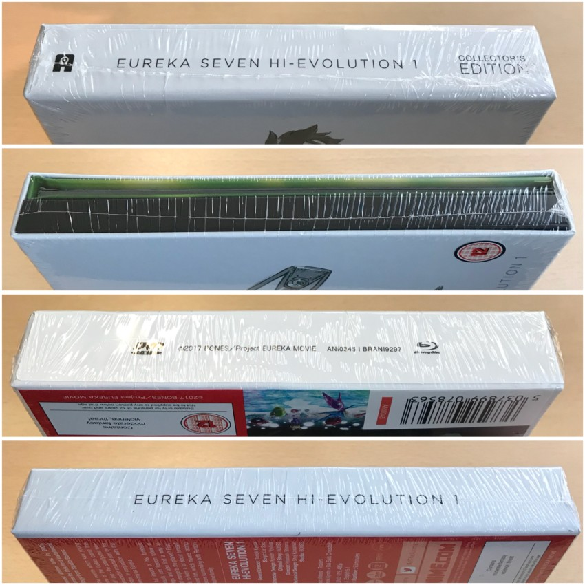 All four spines of the rigid case, cellophane around it.
