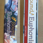 Without the O-card, on the left is how the spine of the product will look. On the right, we find ou Digipak and art book.