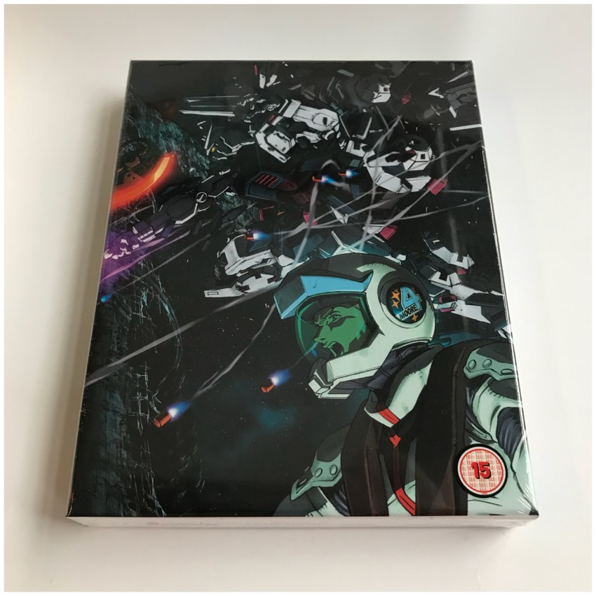 The front of the rigid case, cellophane around the box. NOTE: The BBFC logo is a sticker on the cellophane, not on the box itself.